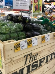 "Crates at the Hy-Vee at 3000 S. Minnesota Ave. in Sioux Falls, South Dakota, holding so-called ""ugly"" produce."