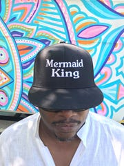 Designer and stylist Andre Wilson, who is the man behind the mermaid's costumes at Forecastle this year, wears his title proudly.
