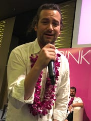 American Idol singer Constantine Maroulis serenades the audience at the Pink Ball press conference at the Dusit Thani Guam Resort on August 3, 2017.