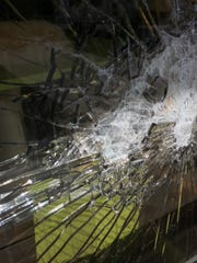 Security cameras show the shattered glass.
