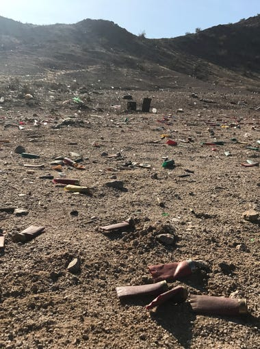 Shotgun shells lie on the ground near Tonopah Salome Highway in Buckeye. Kami Gilstrap was killed by a stray bullet in the area on January 14, 2018.