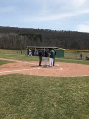 Dad Tank and son Nick Anderson meet at the plate before