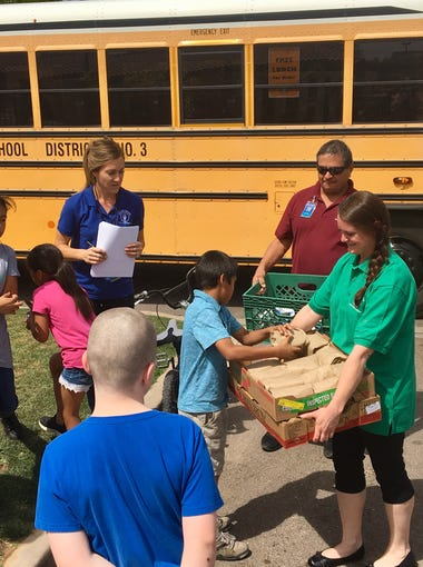 The nutritional services staff from Tempe Elementary School District delivered 257 bagged lunches to children out of school because of the teacher walkout.