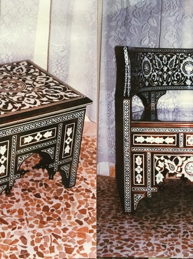 Islamic art patterns and mother of pearl adorn an accent table and chair set made by Bassam Alhalabi's handmade furniture-making business in Syria, Al-Majd. Alhalabi resettled in Tallahassee with his family in December 2016.