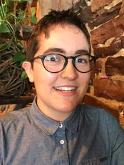 Alex Escaja-Heiss, a peer educator for Outright Vermont, talked about the Youth Risk Behavior Survey results regarding LGBTQ students at Muddy Waters Cafe in Burlington on June 19, 2018.