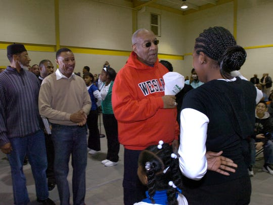 Members of Grade Hy Hilltop Steppers greet Bill Cosby and  Pastor Derrick Johnson (tan sweater).The Exhoodus Tour Event, featuring Cosby, visited the West End Neighborhood House in Wilmington in 2007. The event was designed to provide at-risk youth with important information that will direct them in making positive life choices.
