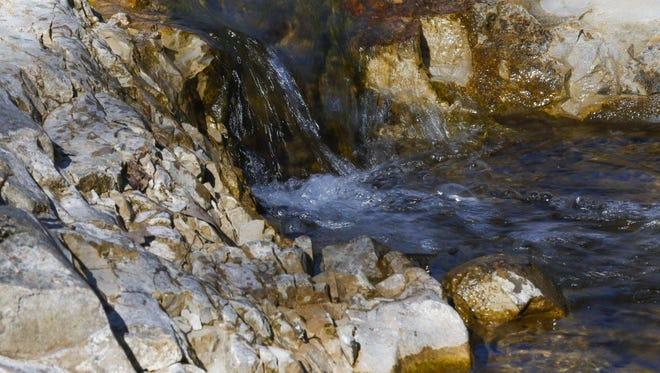 Water gushes down Roark Creek at Ozark Mountain State Park.