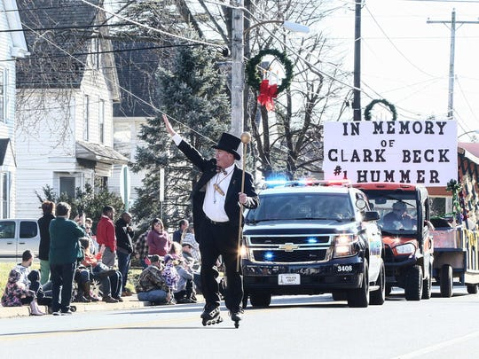 ÒGrand Marshal for LifeÓ Jack Schreppler waves to the crowd during the Middletown Hummers parade on Sunday.