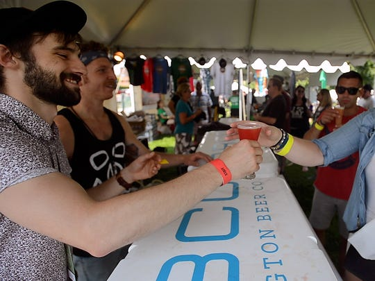 The Burlington Beer Company fills up glasses of a key lime, kumquat tart ale at the Vermont Beer Fest in Burlington on Friday afternoon, July 21, 2017.