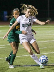 Ridge's Molly Mahoney, right, protects the ball from