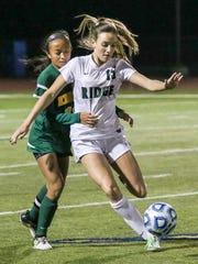 Ridge's Molly Mahoney, right, protects the ball from