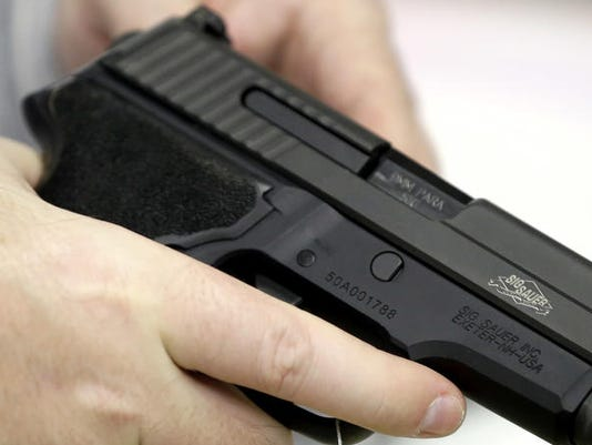 636524846906329314-VA-gun-legislation-AP.jpg