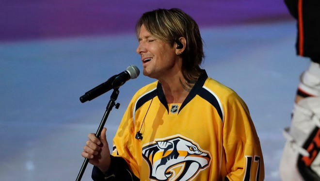 Country Music recording artist Keith Urban sings the national anthem before Game 3 of the Western Conference final series between the Nashville Predators and the Anaheim Ducks.