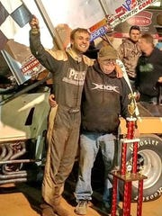 Jacob Allen, left, with his father and car owner Bobby Allen, after Jacob won a Showdown race at Susquehanna Speedway.