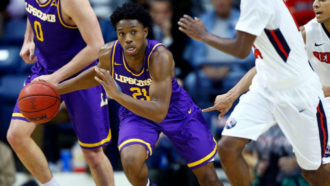 Lipscomb guard Kenny Cooper (21) drives the ball up court during their game against Belmont, Monday, Nov. 27, 2017, in Nashville, Tenn.