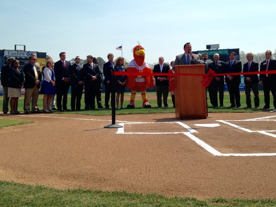 With a crowd of elected officials - and Sherman - behind him, Shorebirds' general manager Chris Bitters talks at the ribbon cutting at Arthur W. Perdue Stadium on April 21, 2016.