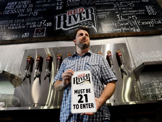 Jared Beville, cofounder at Red River Brewing, holds