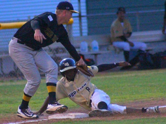 White Sands' Ray Carolina tries to steal third base Saturday night during the season finale at the Griggs Sports Complex.