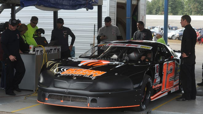 Derek Thorn goes through tech Sunday during the 2013 Snowball Derby Sunday at Five Flags Speedway.