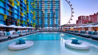The LINQ Pool deck hosts two pools, 35 daybeds, 24 cabanas, a bar, TVs and lily pad daybeds for rent. The pool is free and exclusive to hotel guests.