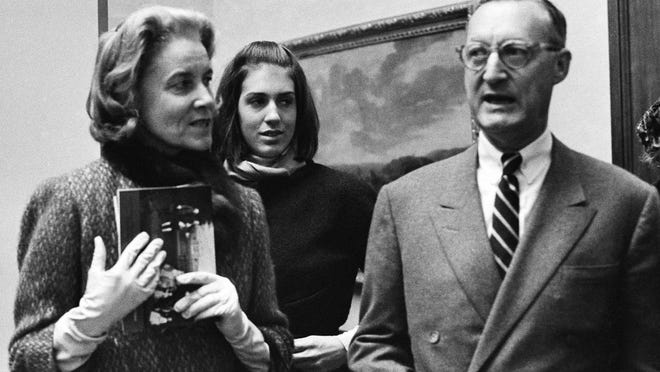 Paul Mellon, of Virginia, his wife, Rachel Bunny Mellon (left) and stepdaughter Eliza Lloyd at preview of the Mellonís collection of English Art at the Royal Academy in London on Dec. 11, 1964. Exhibition opens tomorrow. (AP Photo) ORG XMIT: APHS328367 [Via MerlinFTP Drop]