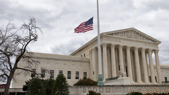 Tthe Supreme Court building front plaza flies in Washington.