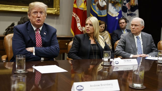 President Trump and Attorney General Jeff Sessions, along with Florida Attorney General Pam Bondi.