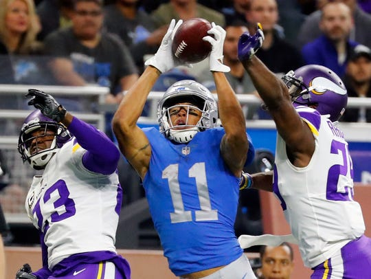 Lions receiver Marvin Jones, guarded by Vikings cornerbacks Terence Newman (23) and Xavier Rhodes, catches a 43-yard touchdown in the second half Nov. 23.