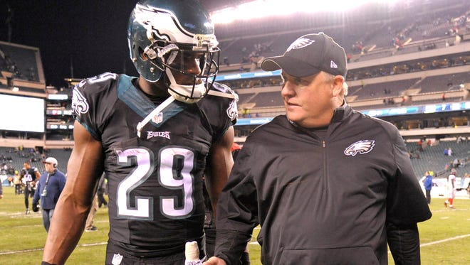 Philadelphia Eagles head coach Chip Kelly and running back DeMarco Murray (29) walk off the field after win over the New York Giants at Lincoln Financial Field.