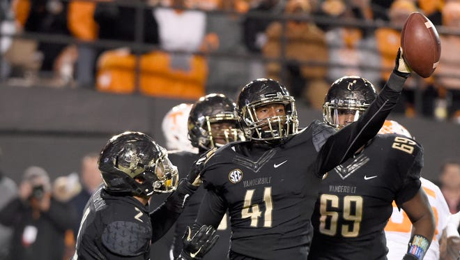 Vanderbilt linebacker Zach Cunningham (41) celebrates his fumble recovery in the first half against Tennessee on Nov. 26, 2016.