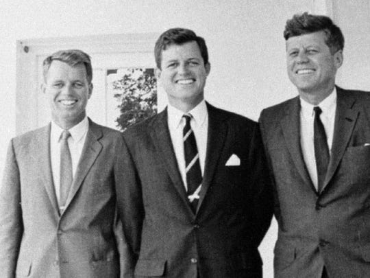 In this 1962 file photo, Sen. Edward M. Kennedy, center, poses with his brothers U. S. Attorney General Robert F. Kennedy, left, and President John F. Kennedy at the White House in Washington. (AP Photo, File)