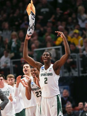 The Michigan State bench, led by Jaren Jackson Jr., celebrates during the second half of the 82-78 win against Bucknell on Friday, March 16, 2018 at Little Caesars Arena.