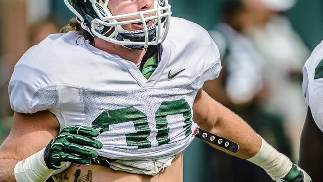 MSU linebacker Riley Bullough runs through a drill during a summer camp practice Wednesday August 6, 2014 at the Duffy Daugherty Building in East Lansing.