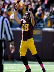 Minnesota kicker Ryan Santoso celebrates a 52-yard field goal against Purdue.
