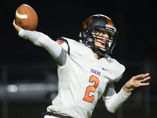 Woodrow Wilson's Nick Kragman throws a pass during
