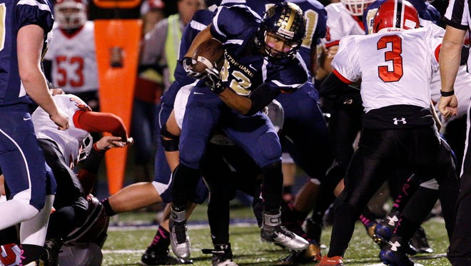 Notre Dame's Tim Davis carries the ball last week against Groton.