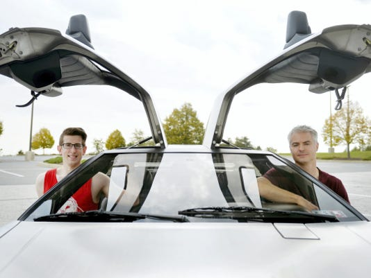 "Matt Bozievich of, Shrewsbury Township, and Justin Mettee, of Codorus Township, sit for a portrait in Mettee's 1981 DeLorean in the parking lot of the Wal-Mart in Shrewsbury. Oct. 21, 2015, is the date to which Marty McFly and Doc Brown travel to in the 1989 movie ""Back to the Future Part II."""