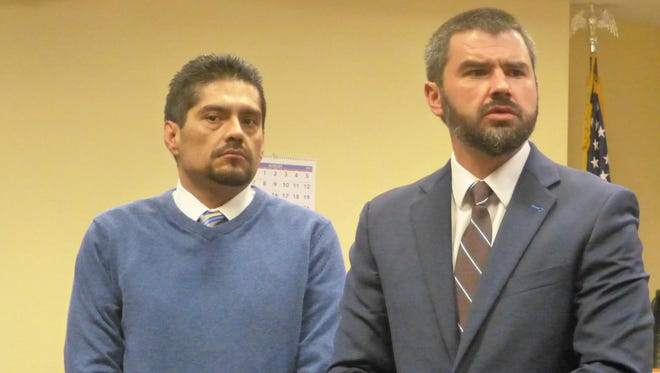 Juan Venegas, left, and defense attorney Michael Borges are shown during this summer's murder trial.