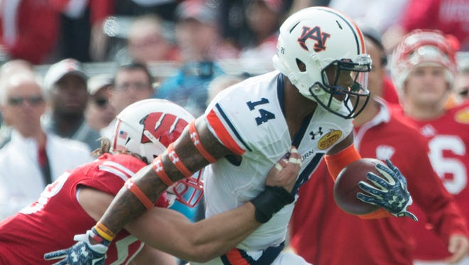 Auburn quarterback Nick Marshall will play quarterback at the Senior Bowl.