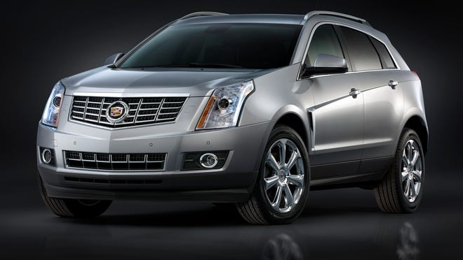General Motors put a prototype Super Cruise self-driving system into a Cadillac SRX SUV like this 2014 model and demonstrated it recently. GM says Super Cruise autonomous vehicles are coming in 2020.