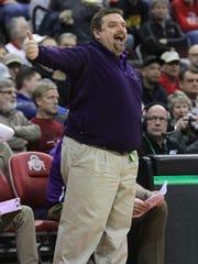 Lexington coach Scott Hamilton calls out a play during