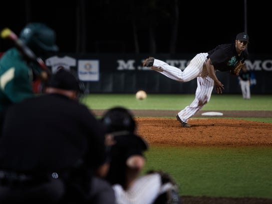 Lafayette High's Miguel Reyes delivers a pitch during