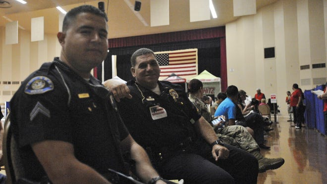 Tulare police Crpl. German Barrios, left, and Lt. Jerod Boatman await their turn at the 2016 Tulare Memorial Blood Drive on Sunday. The event netted nearly 900 pints for the Central Valley Blood Center.