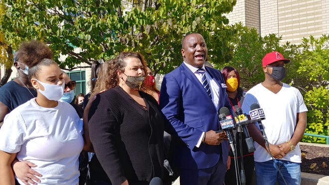 Attorney Nenye Uche of Chicago stands outside of Rockford City Hall on Thursday, Oct. 8, 2020, with the family of Tyris Jones, a 21-year-old man shot in the back by a Rockford police officer on Oct. 2.