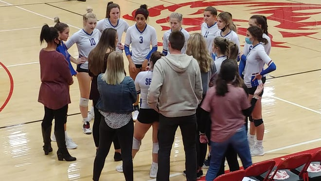 Seaman's Camryn Turner (#3) huddles up with teammates and coaches after the second set of Tuesday night's Class 5A state quarterfinal against Lansing. Turner's block gave the Vikings the third set, but her team's season ultimately came to a close as the one-loss Lions took a 25-23, 25-9, 16-25, 25-18 victory.