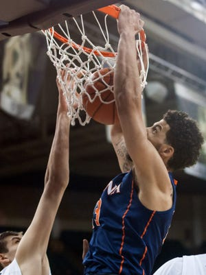 Virginia Cavaliers forward Anthony Gill (13) dunks the ball during the second half against the Wake Forest Demon Deacons at Lawrence Joel Veterans Memorial Coliseum. Virginia defeated Wake Forest 70-34.