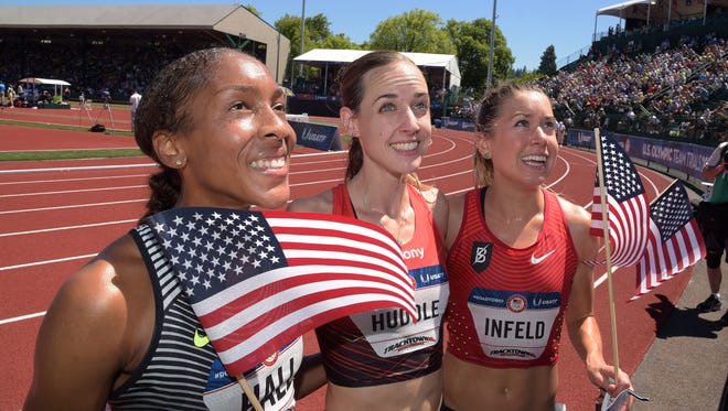 Haddonfied High School graduate Marielle Hall (left) holds an American flag while standing next to Molly Huddle (middle) and Emily Infeld (right) after the trio qualified for the Olympics in the 10,000-meter run on July 2.