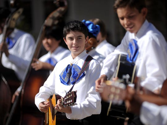 Fox Bonner, center, plays guitar with the Data Middle School mariachi band during a Dia de los Muertos celebration two years ago.