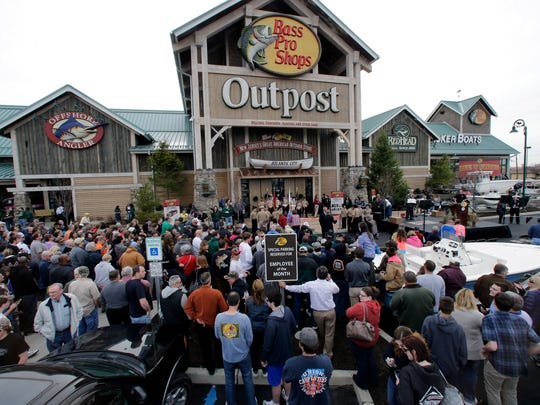 People wait for the grand opening of the Bass Pro Shops