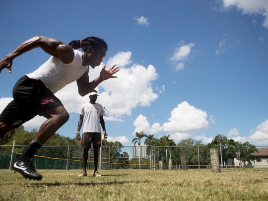 Lehigh Senior High and UNLV standout Robert Jackson works out with LeDondrick Rowe at Shady Oaks Park in east Fort Myers on April 4. He is hoping to get drafted into the NFL or signed as a free agent.